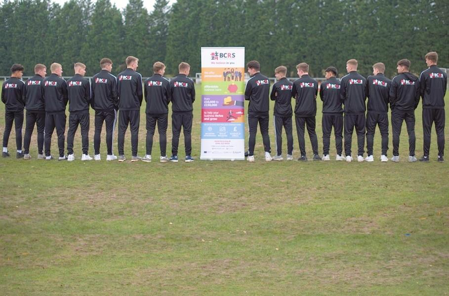 Worcester City Youth Football Team with BCRS Business Loans Banner